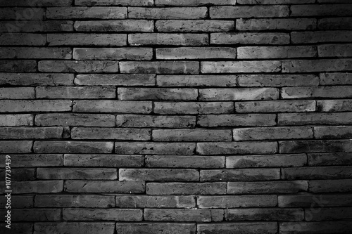 Foto op Plexiglas Dark brick wall with shadow for pattern and background
