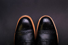 Black Oxford Shoes With Shoelace On Black Background Closeup, Top View