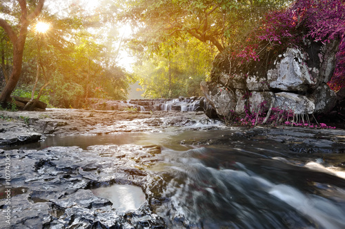 Montage in der Fensternische Forest river beautiful water fall in thailand