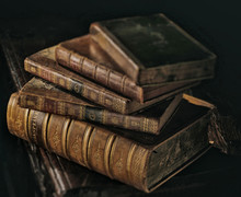 Shakespeare Old Books Stack Dark Directional Light. Selective Focus On Shakespeare Title.
