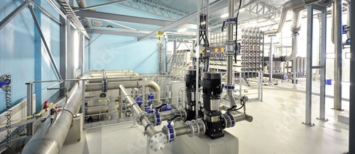 new shiny pipes and large pumps in industrial boiler room Canvas Print