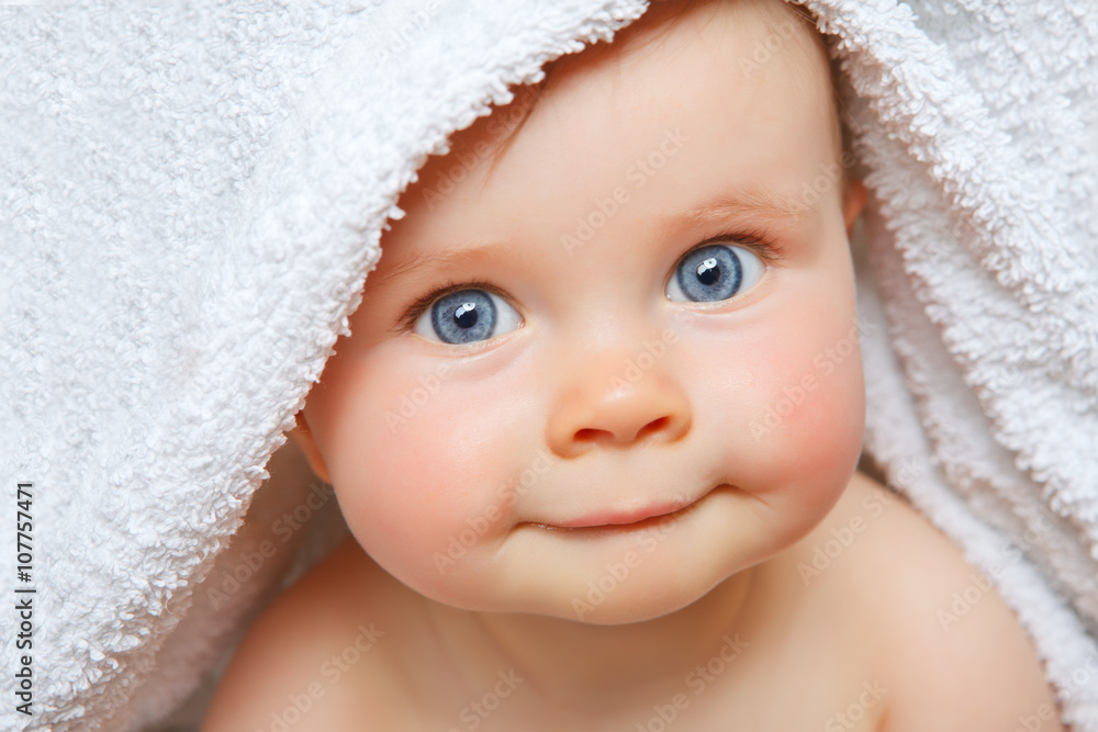 Fototapeta baby under a towel