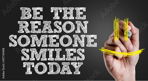 Hand writing the text: Be The Reason Someone Smiles Today Wallpaper Mural