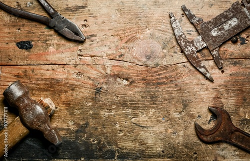 Fotografie, Obraz  Top view of basic used partial tools on rustic wooden board
