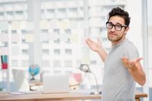 Man Shrugging His Shoulder In Office