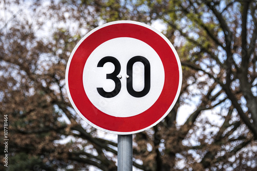 Fotografía  Germany: Traffic sign with speed limit 30 kilometers