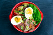 Duck noodles with egg, vegetables and duck meat in bowl
