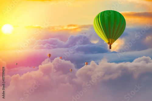 colorful hot air balloons with cloudy sunrise background