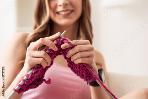 Photo  Positive girl knitting