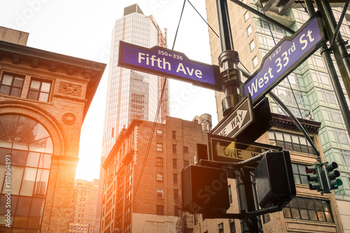 Photo  Street sign of Fifth Ave and West 33rd St at sunset in New York City - Manhattan