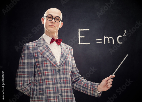 bald caucasian professor or teacher with bow tie and glasses point stick on blac Poster Mural XXL