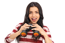 Confident Woman Holding A Pair Of Binoculars