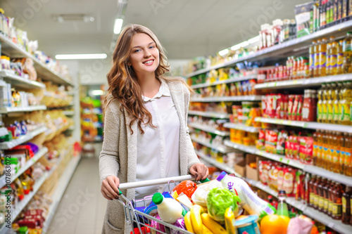 Housewives, women with shopping cart in supermarket