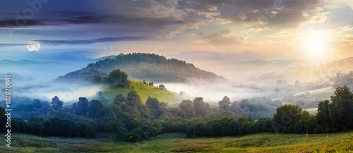Fototapeta mysterious fog on hillside in rural area obraz