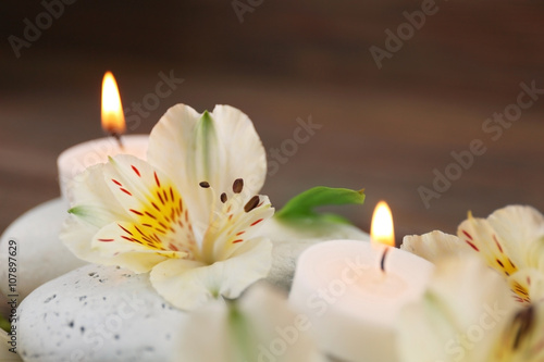 Fototapety, obrazy: Spa still life with stones, flowers and candlelight closeup