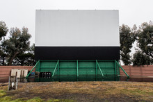 Drive In Movie Area With Screen And Speaker Poles