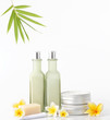 Spa concept - natural cosmetic products with bamboo and frangipani flower on white