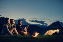 Three Friends Camping With Fir...