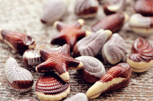Swiss Chocolate Seashells On Wooden Background