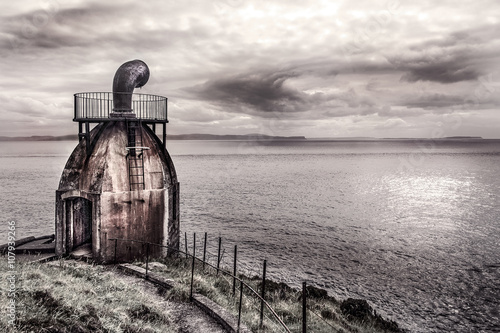 Photo  Old signal horn of the Mull of Kintyre on the coast of Scotland