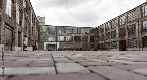 Photo sur Toile Les vieux bâtiments abandonnés Ground level view of old warehouse exterior