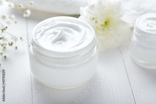 Fotografie, Obraz  Anti wrinkle cosmetic cream with herbal flowers face, skin and body care hygiene
