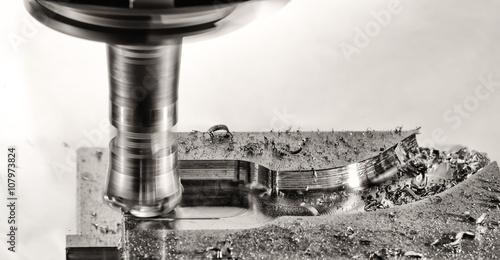 Fotografie, Obraz  Milling cutter work with splinters flying off, monochrome versio