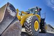 canvas print picture - Heavy equipment machine wheel loader on construction jobsite