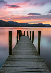 FototapetaVibrant pink and orange sunset at Ashness Jetty in the Lake District, UK.