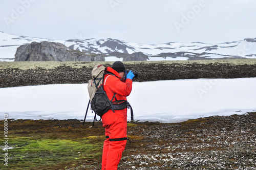 Photo Stands Antarctic Researcher on the landscape of the Antarctica, South pole