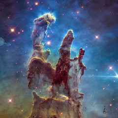 The Eagle Nebula's Pillars of Creation. Retouched image. Elements of this image furnished by NASA.