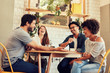 canvas print picture - Young friends having a great time in restaurant