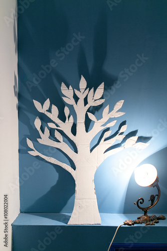Canvas Print Beautiful handmade paper tree silhouette in the artist's studio