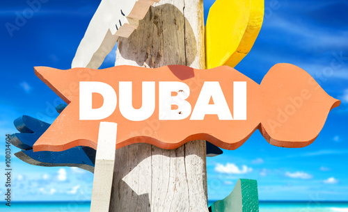 Fotografie, Obraz  Dubai signpost with beach background