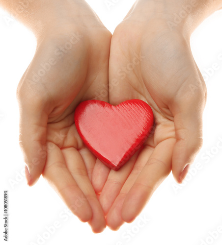 Fototapeta Decorative heart in female hands, isolated on white obraz na płótnie