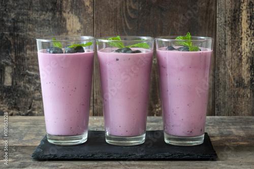 Garden Poster Milkshake Fresh blueberry smoothie on rustic wood