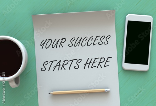 Fotografía  Your Success Starts Here, message on paper, smart phone and coffee on table, 3D