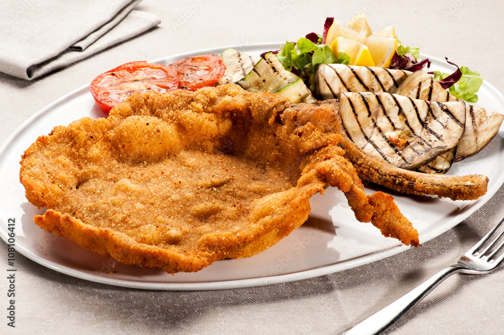 Fotografie, Tablou  Fried Milanese cotoletta with tomatoes on plate
