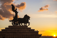 Goddess Victoria Riding On Quadriga, Altar Of The Fatherland On The Sunset. Rome, Italy