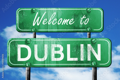 dublin vintage green road sign with blue sky background Poster