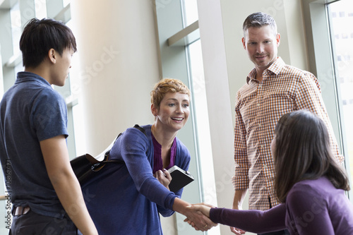 Business people shaking hands in office Poster