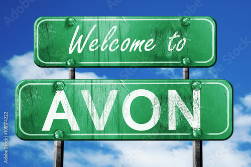 avon vintage green road sign with blue sky background Canvas Print