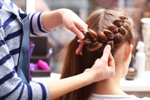 Professional Hairdresser Braiding Clients Hair