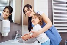 Mom Washing Baby Hands
