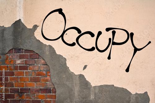 Foto op Aluminium Graffiti Handwritten graffiti Occupy sprayed on the wall, anarchist aesthetics