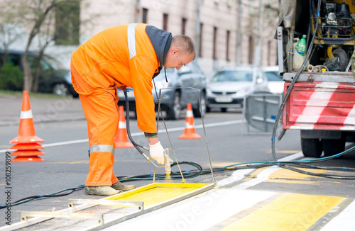 Technical person man worker painting and remarking