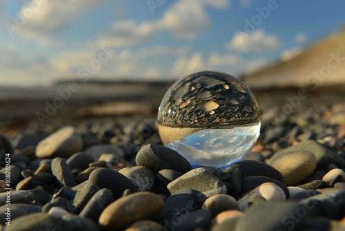 Beach ball, U.K. A crystal ball on a beach.