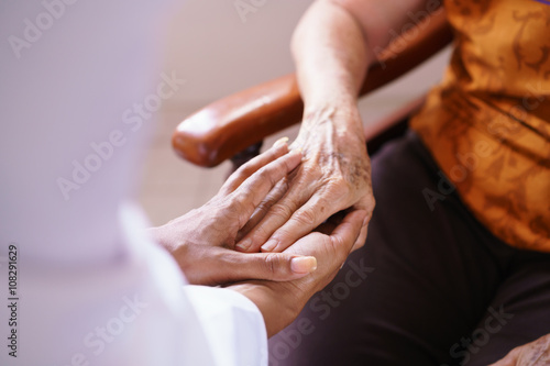 Slika na platnu Doctor Vising Senior Woman In Old People Home