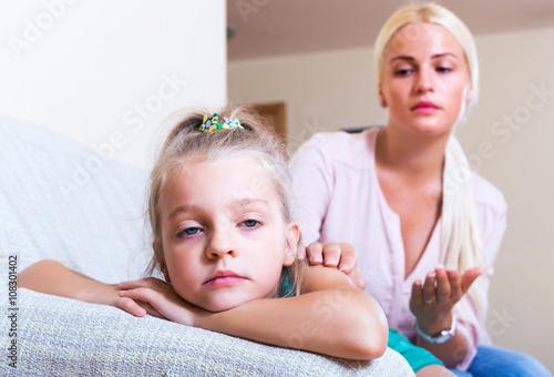Valokuva  Nanny calming a fretful child
