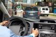 Hands of man with steering wheel.